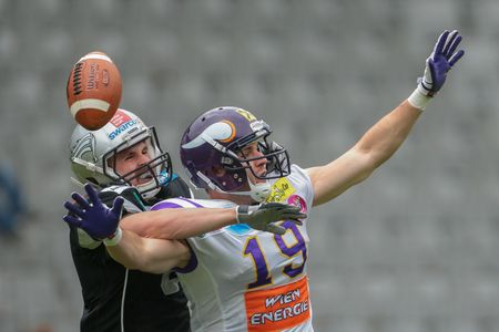 afl: INNSBRUCK, AUSTRIA - MAY 3, 2014: DB Arno Andreas (#8 Raiders) and Stefan Postel (#19 Vikings) fight for the ball.