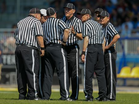 VIENNA, AUSTRIA - MAY 26, 2014: The referee crew has a discussion.