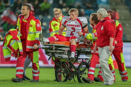 GRAZ, AUSTRIA - MAY 31, 2014: LB Timmi Kleinnibbelink Rysgaard (#2 Denmark) is transported off the field after an injury. Editorial