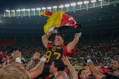 football european championship: VIENNA, AUSTRIA - JUNE 7, 2014: WR Jan Hilgenfeldt (#87 Germany) celebrates the win of his team in the finals.