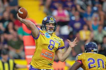 field goal: ST. POELTEN, AUSTRIA - JULY 26, 2014: QB Christoph Gross (#8 Vikings) passes the ball during Austrian Bowl XXX.