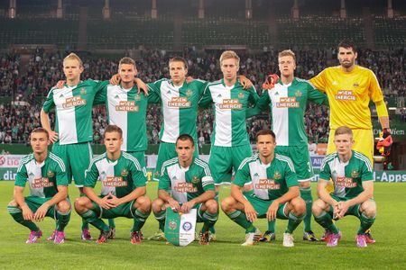 qualifier: VIENNA, AUSTRIA - AUGUST 28, 2014: The team of SK Rapid poses before the Europa League qualifier against HJK Helsinki before an UEFA Europa League qualifying game. Editorial
