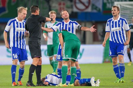 camaraderie: VIENNA, AUSTRIA - AUGUST 28, 2014: Teemu Tainio (#10 Helsinki) argues with Referee Stephane Laurent Lannoy (France) in an UEFA Europa League qualifying game.