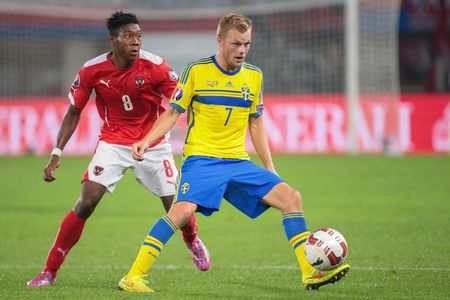camaraderie: VIENNA, AUSTRIA - SEPTEMBER 9, 2014: David Alaba (#8 Austria) and Sebastian Larsson (#7 Sweden) fight for the ball in an European Championship qualifying game. Editorial