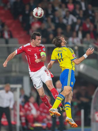 9 ball: VIENNA, AUSTRIA - SEPTEMBER 9, 2014: Christian Fuchs (#5 Austria) and Johan Elmander (#11 Sweden) fight for the ball in an European Championship qualifying game. Editorial