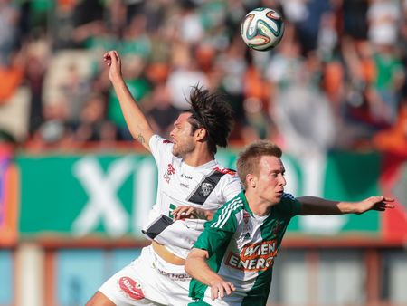 9 ball: VIENNA, AUSTRIA - SEPTEMBER 20, 2014: Nemanja Rnic (#15 Wolfsberg) and Robert Beric (#9 Rapid) fight for the ball in an Austrian soccer league game.