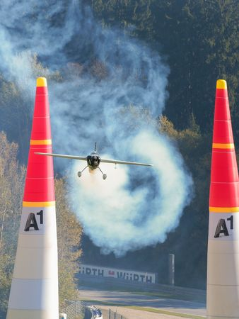 michael: SPIELBERG, AUSTRIA - OCTOBER 25, 2014: Michael Goulian (USA) competes in the Red Bull Air Race. Editorial
