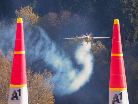 competes: SPIELBERG, AUSTRIA - OCTOBER 25, 2014: Martin Sonka (Czech Republic) competes in the Red Bull Air Race.