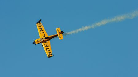 competes: SPIELBERG, AUSTRIA - OCTOBER 25, 2014: Nigel Lamb (Great Britain) competes in the Red Bull Air Race. Editorial