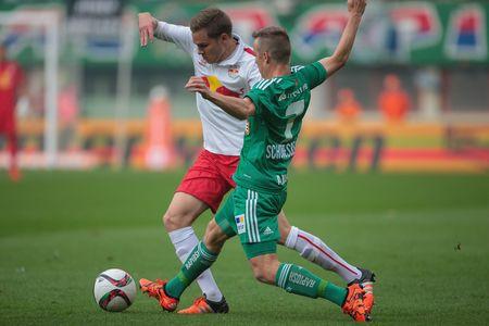VIENNA, AUSTRIA - OCTOBER 4, 2015: Benno Schmitz (RB Salzburg) and Philipp Schobesberger (SK Rapid) fight for the ball in an Austrian Football League game.