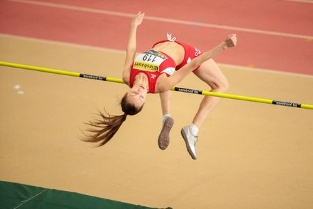 competes: LINZ, AUSTRIA - FEBRUARY 22, 2015: Ekaterina Kuntsevich (#119 Austria) competes in the womens high jump event in an indoor track and field event. Editorial