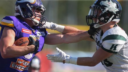 VIENNA, AUSTRIA - JULY 10, 2016: Daniel Hnilitzka (Danube Dragons) tackles Dominik Bundschuh (Vienna Vikings) in a game of the Austrian Football League.