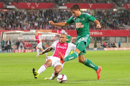 ajax: VIENNA, AUSTRIA - JULY 29, 2015: Stefan Schwab (SK Rapid) and Kenny Tete (Ajax) fight for the ball in an UEFA Champions League qualification game. Editorial
