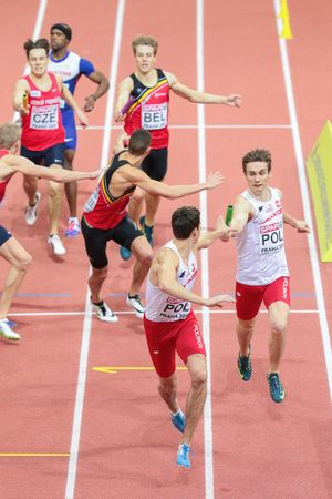 PRAGUE, CZECH REPUBLIC - MARCH 8, 2015: Karol Zalewski (Poland) and Rafal Omelko (Poland) compete in the mens 4x400m relay event of the European Athletics Indoor Championship.