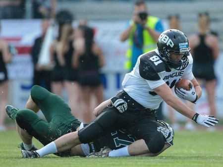 81: VIENNA, AUSTRIA - MAY 16, 2015: CB Ivan Kozlov (#27 Dragons) tackles WR Martin Šindler (#81 Panthers) in a game of the Austrian Football League.