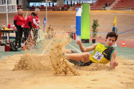 competes: VIENNA, AUSTRIA - JANUARY 31, 2015: Milan Mladenovic (#376 Serbia) competes in the mens long jump event during an indoor track and field event.