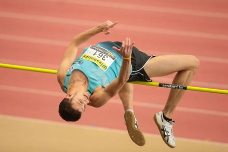 field event: LINZ, AUSTRIA - FEBRUARY 22, 2015: Josip Kopic (#361 Austria) competes in the mens high jump event in an indoor track and field event.