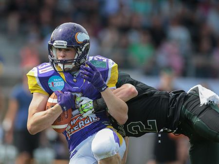 VIENNA, AUSTRIA - MAY 31, 2015: CB Maximilian Katzenbeisser (#2 Dragons) tackles WR Dominik Bundschuh (#3 Vikings) in a game of the Austrian Football League.