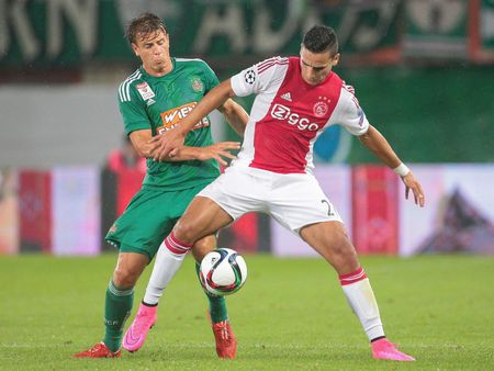 ajax: VIENNA, AUSTRIA - JULY 29, 2015: Stefan Schwab (SK Rapid) and Anwar El Ghazi (Ajax) fight for the ball in an UEFA Champions League qualification game.