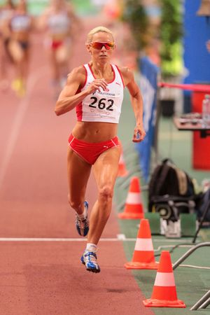 competes: VIENNA, AUSTRIA - JANUARY 31, 2015: Jenny Meadows (#262 Great Britain) competes in the womens 800m event during an indoor track and field event.