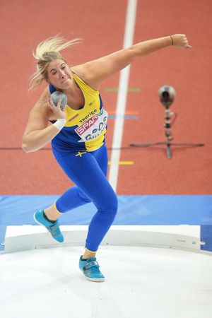 competes: PRAGUE, CZECH REPUBLIC - MARCH 5, 2015: Fanny Roos (#760 Sweden) competes in the womens shot put event of the European Athletics Indoor Championship.