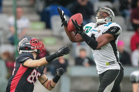 db: INNSBRUCK, AUSTRIA - APRIL 11, 2015: DB Talib Wise (#4 Raiders) catches the ball in a game of the Big Six Football League. Editorial
