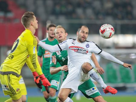 VIENNA, AUSTRIA - OCTOBER 28, 2015: Mario Sonnleitner (SCR) and Leonard Kaufmann (SBG) fight for the ball in an Austrian Football Cup game. Editorial