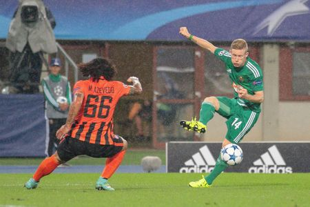 uefa: VIENNA, AUSTRIA - AUGUST 19, 2015: Marcio Azevedo (FC Shakhtar) and Florian Kainz (SK Rapid) fight for the ball in an UEFA Champions League qualification game.