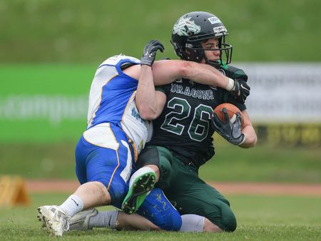 lb: VIENNA, AUSTRIA - MAY 3, 2015: LB Marco Z�chner (#6 Giants) tackles RB Manuel Chytilek (#26 Dragons) in a game of the Austrian Football League.