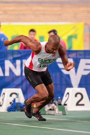 field event: VIENNA, AUSTRIA - JANUARY 31, 2015: Fabiano Gilberto Da Silva (#188 Brazil) competes in the mens 60m event during an indoor track and field event.