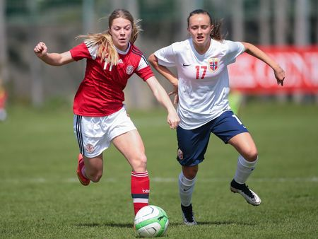 LINDABRUNN, AUSTRIA - APRIL 13, 2015: Freja Kjaersig Sunesen (#11 Denmark) and Andrea Wilmann (#17 Norway) fight for the ball during a UEFA womens U17 qualifying game.