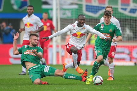 VIENNA, AUSTRIA - OCTOBER 4, 2015: Phillipp Prosenik (SK Rapid) and Naby Keita (RB Salzburg) fight for the ball in an Austrian Football League game. Stock Photo - 60814733