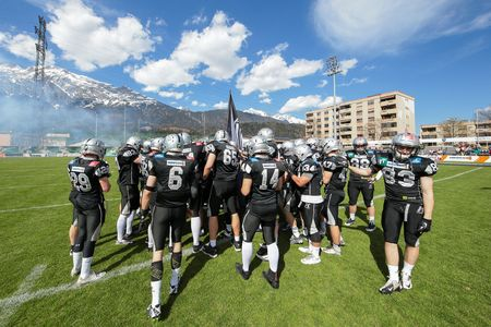 INNSBRUCK, AUSTRIA - APRIL 12, 2015: The team of the Swarco Raiders is in the huddel before a game of the Austrian Football League.
