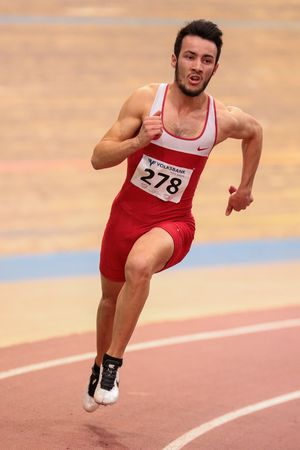 field event: VIENNA, AUSTRIA - JANUARY 31, 2015: Altintas Batuhan (#278 Turkey) competes in the mens 400m event during an indoor track and field event. Editorial