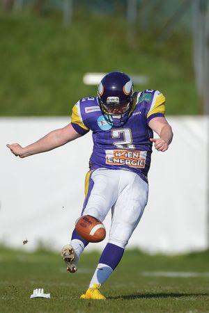 vikings: VIENNA, AUSTRIA - APRIL 19, 2015: K Christopher Kappel (#2 Vikings) kicks the ball in a game of the Austrian Football League.