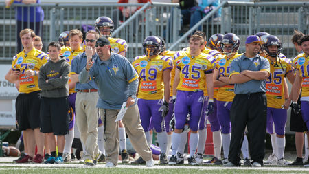 instructs: VIENNA, AUSTRIA - MAY 10, 2015: Head Coach Thomas Oelboeck instructs his team in a game of the Division I of the Austrian Football League. Editorial