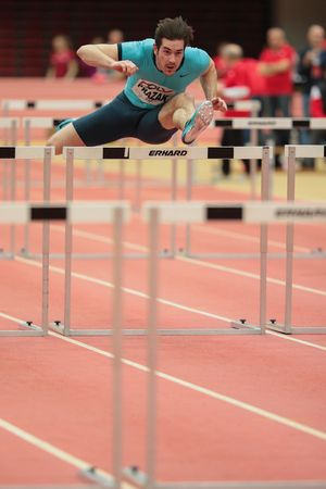 field event: LINZ, AUSTRIA - FEBRUARY 6, 2015: Manuel Prazak (#257 Austria) competes in the menS 60m hurdles event in an indoor track and field event. Editorial