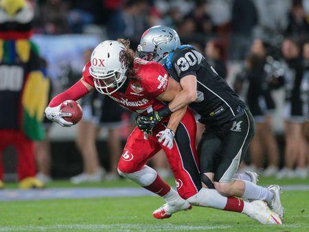 db: INNSBRUCK, AUSTRIA - MAY 2, 2015: DB Alexander Achammer (#30 Raiders) tackles TE Evan Landi (#87 Lions) in a game of the Big SIx Football League.