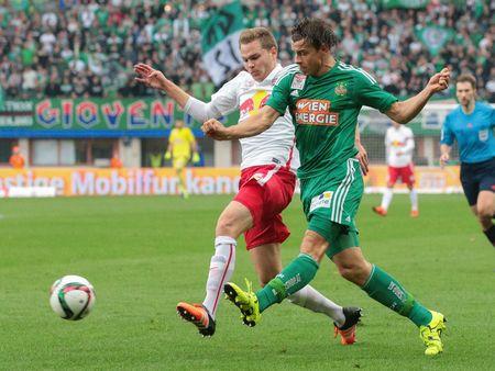 camaraderie: VIENNA, AUSTRIA - OCTOBER 4, 2015: Benno Schmitz (RB Salzburg) and Stefan Schwab (SK Rapid) fight for the ball in an Austrian Football League game. Editorial