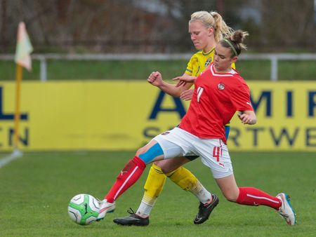 camaraderie: SANKT POELTEN, AUSTRIA - APRIL 13, 2015: Josefine Rybrink (#2 Sweden) and Laura Wienroither (#4 Austria) fight for the ball during a UEFA womens U17 qualifying game. Editorial