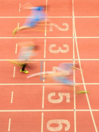 field event: LINZ, AUSTRIA - FEBRUARY 21, 2015: Runners cross the finishing line in the mens 60m event in an indoor track and field event.