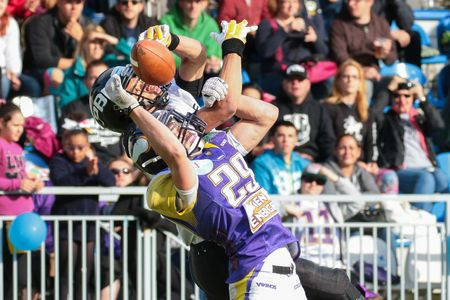db: VIENNA, AUSTRIA - JUNE 20, 2015: DB Andreas Lunzer (#29 Vikings) tackles WR Jakub Wolesky (#2 Panthers)  in a game of the Austrian Football League. Editorial
