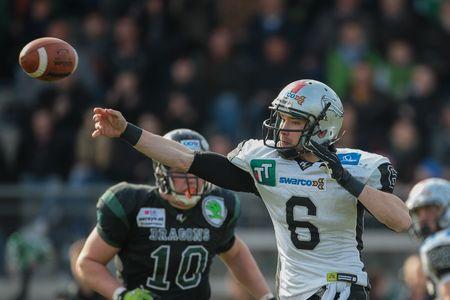 kyle: VIENNA, AUSTRIA - APRIL 4, 2015: QB Kyle Callahan (#6 Raiders) throws the ball in a game of the Austrian Football League.