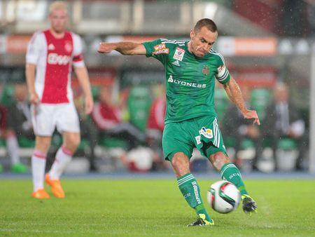 camaraderie: VIENNA, AUSTRIA - JULY 29, 2015: Steffen Hofmann (SK Rapid) kicks the ball in an UEFA Champions League qualification game.