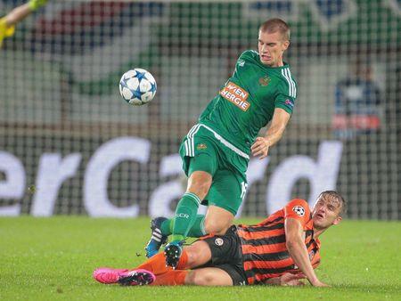 VIENNA, AUSTRIA - AUGUST 19, 2015: Srdjan Grahovac (SK Rapid) kicks the ball in an UEFA Champions League qualification game.