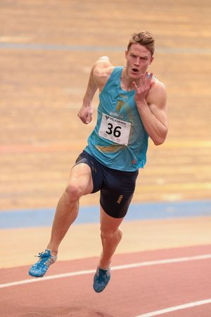 field event: VIENNA, AUSTRIA - JANUARY 31, 2015: Luka Janezic (#36 Slovenia) competes in the mens 400m event during an indoor track and field event.