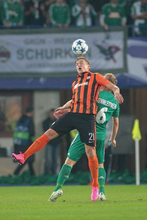 camaraderie: VIENNA, AUSTRIA - AUGUST 19, 2015: Olexandr Gladkiy (FC Shakhtar) and Mario Sonnleitner (SK Rapid) fight for the ball in an UEFA Champions League qualification game. Editorial