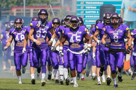 vikings: VIENNA, AUSTRIA - MAY 22, 2016: The team of the Vienna Vikings run on the field before a game of the Austrian Football League.