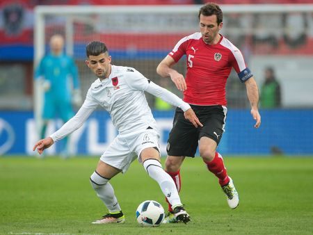 camaraderie: VIENNA, AUSTRIA - MARCH 26, 2016: Christian Fuchs (Austria) and Elseid Hysaj (Albania) fight for the ball in a friendly football game. Editorial