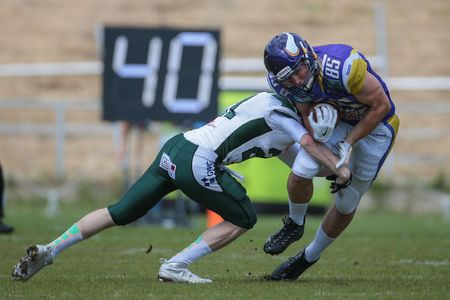 cb: VIENNA, AUSTRIA - MAY 17, 2015: CB Christian Köppe (#21 Unicorns) tackles WR Joey Gabrick (#85 Vikings) in a game of the Big Six Football League. Editorial